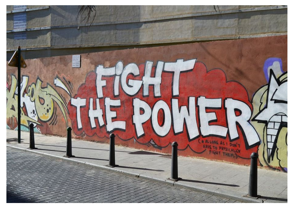 Wall mural reads Fight the Power